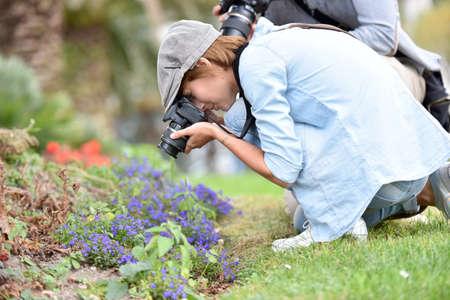 vegetation: Photographers in park shooting vegetation