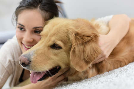 cuddles: Portrait of woman with dog Stock Photo