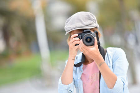 contest: Young woman photographer on a shooting day in town Stock Photo