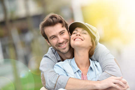 Portrait of in love young couple in town. Stock Photo