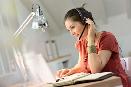 business casual: Woman telemarking assistant working from home Stock Photo