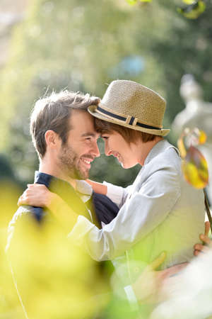couples hug: Young couple in love embracing in park