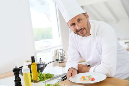 40 years old man: Closeup of smiling cook in kitchen