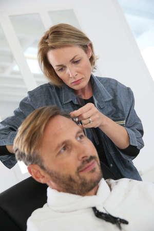 haircut: Middle-aged man having a haircut at hairdressing salon
