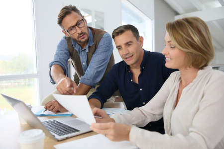 mature man: Financial department people working on budget plan Stock Photo