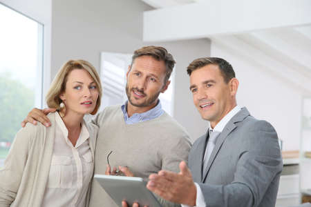 realtor: Realtor presenting new apartment to clients