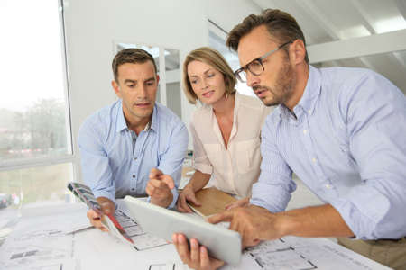 workteam: Team of architects meeting in office Stock Photo