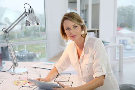 housing project: Woman designer working on housing project