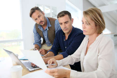 group of workers: Financial department people working on budget plan Stock Photo