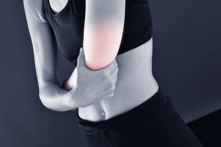 Athletic girl with painful elbow, isolated Stock Photo