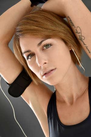 slim girl: Portrait of athletic girl on grey background, isolated