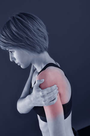 Closeup of fitness girl with biceps pain, isolated Stock Photo