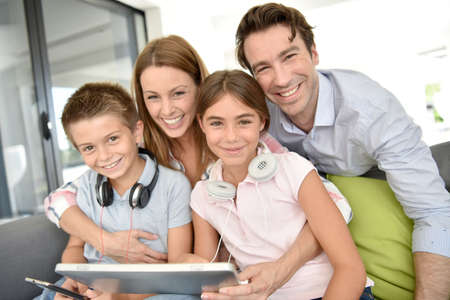 family playing: Portrait of happy family playing with tablet