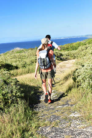 indies: Couple on a trekking day in Caribbean island Stock Photo