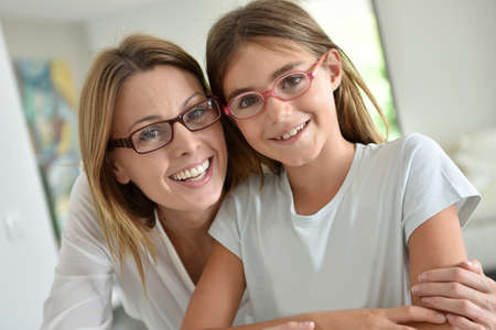 girl glasses: Portrait of mother and daughter with eyeglasses