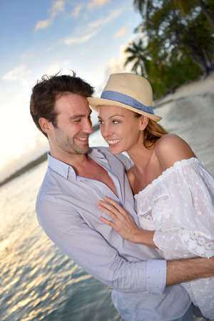 30 years old married couple: Portrait of cheerful couple on vacation in Caribbean island
