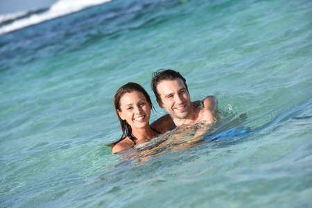 30 years old married couple: Cheerful couple enjoying sea bath in Caribbean island Stock Photo