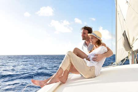 couple relaxing: Romantic couple enjoying sail cruise on Caribbean sea