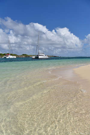 crystal clear: View of crystal clear Caribbean sea and boats in background Stock Photo