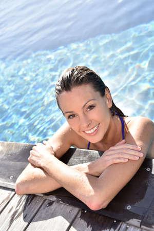 caribe: Portrait of beautiful woman in swimming pool Stock Photo