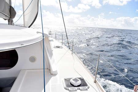 sailing boats: Catamaran sailing on Caribbean sea