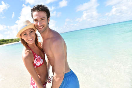 30 years old married couple: Young married couple embracing on the beach Stock Photo