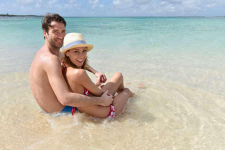 30 years old married couple: Couple relaxing on the beach in Caribbean island
