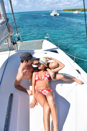 cruising: Couple relaxing on a cruising boat deck Stock Photo