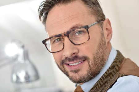 casual men: Portrait of handsome middle-aged man with eyeglasses