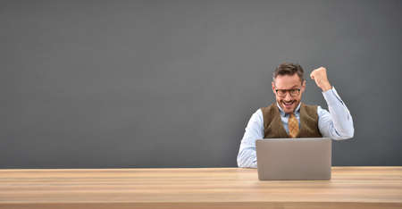 textspace: Businessman in front of laptop , successful expression Stock Photo