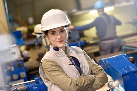 Portrait of metal worker standing in workshop