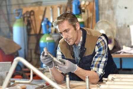45 years old: Worker in metallurgy workshop Stock Photo