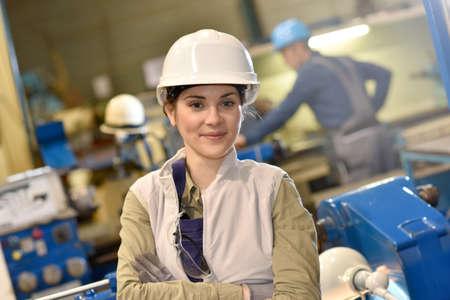 metal worker: Portrait of metal worker standing in workshop