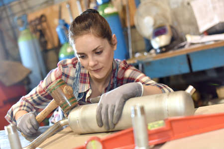 metallurgy: Woman in metallurgy workshop Stock Photo