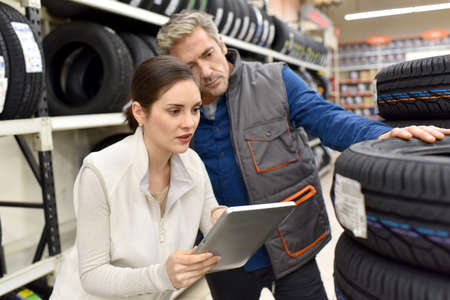 merchandiser: Mechanics with merchandiser checking products availibility