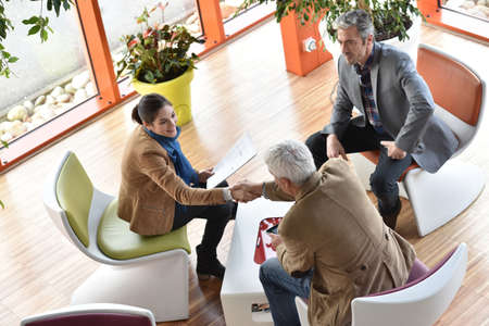 business partners: Business people gathering in meeting area