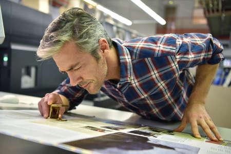 印刷の家ではたらく人 写真素材