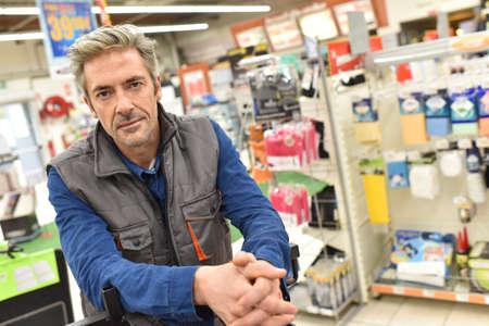 merchandiser: Closeup of merchandiser standing in store Stock Photo