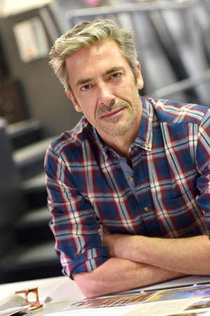 Portrait of mature man working in printing house Stock Photo