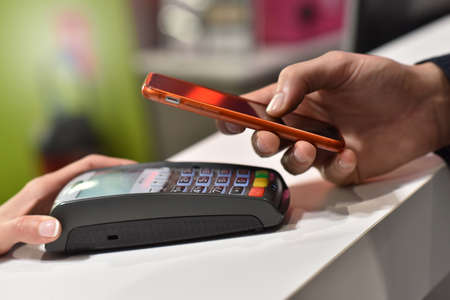 payments: Direct payment with smartphone, Near field communication Stock Photo