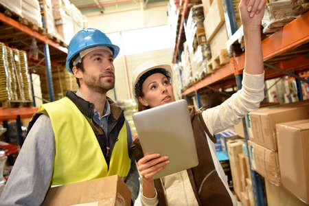 warehouseman: Store manager with warehouseman checking stock levels