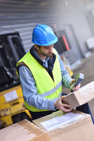 warehouseman: Warehouseman on dock scanning products ready for shipment Stock Photo