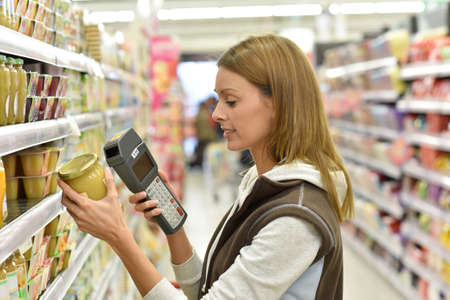 scanning: Sales assistant scanning products before putting them on shelves