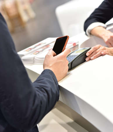 technology transaction: Direct payment with smartphone, Near field communication Stock Photo