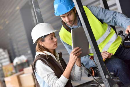 warehouseman: Warehouseman driving cart, listening to operator instructions