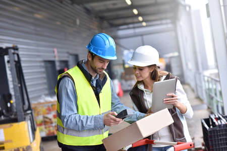 warehouseman: Store manager with warehouseman checking goods reception