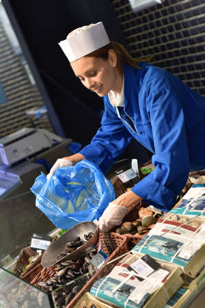 fishmonger: Fishmonger woman at work Stock Photo