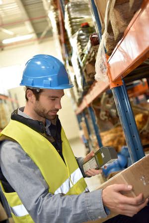 warehouseman: Warehouseman scanning products ready for delivery Stock Photo