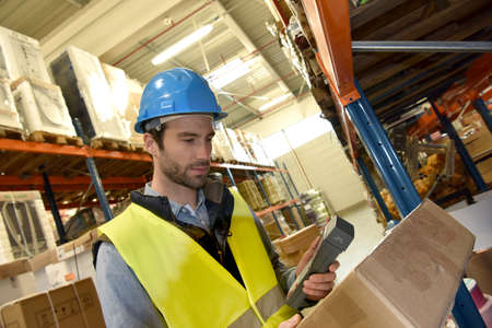 logistics: Warehouseman scanning products ready for delivery Stock Photo