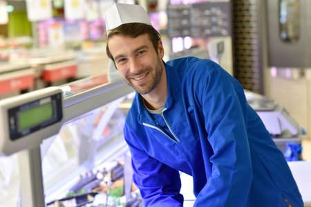 fishmonger: Portrait of smiling fishmonger with blue uniform